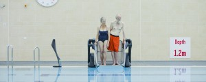 Elderly couple using Poolpod to access the pool.